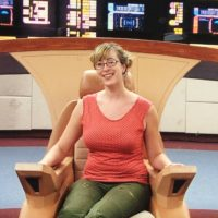 A picture of Cat sitting on the Captain's chair of the Enterprise-D