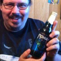 Image of Henry Pomper holding a bottle of Romulan Ale