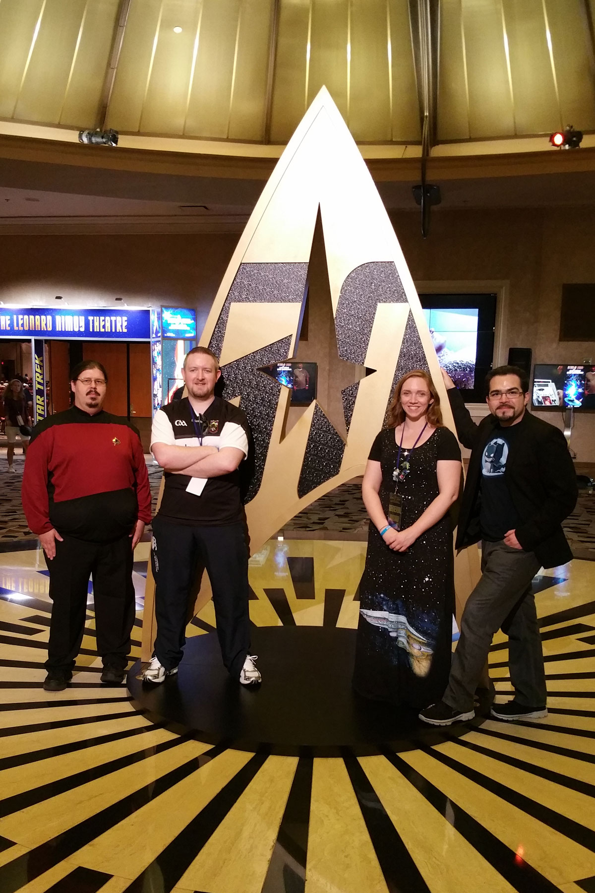 Left to Right: Henry, Winters, Kenna, and Elijah in front of a large 50th Anniversay Star Trek Statue