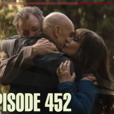 Deanna and Will embracing Picard from the episode Nepenthe