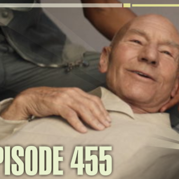 Image of Picard laying in Raffi's Arms